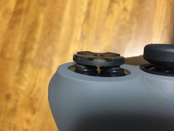 Four way controller key on the ps4 controller seen from the side