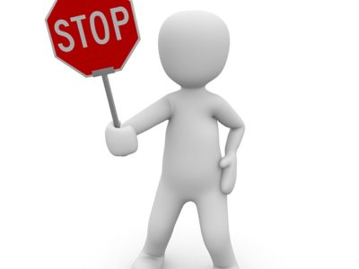 Person with stop sign